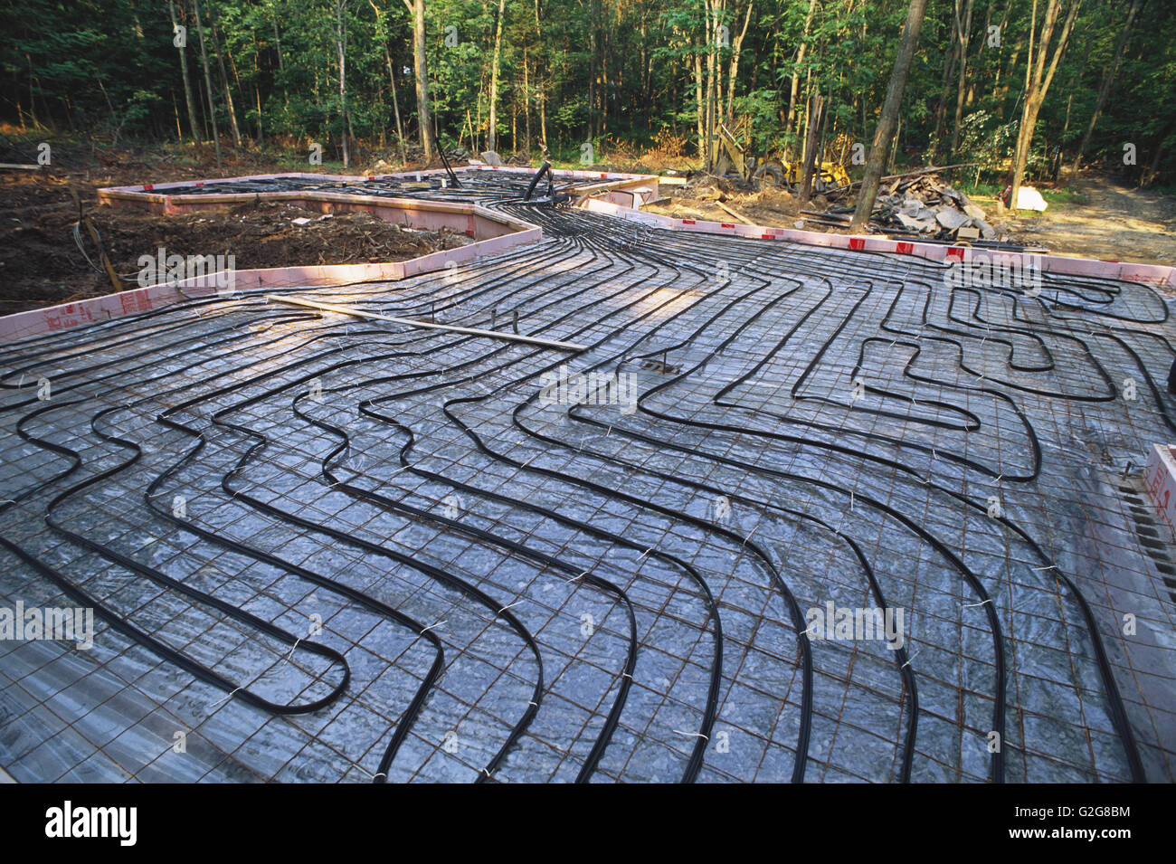 Radiant heat pipes before concrete pour - Stock Image