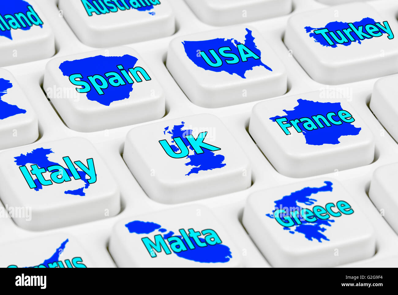 Travel. Various destination countries on a computer keyboard. - Stock Image