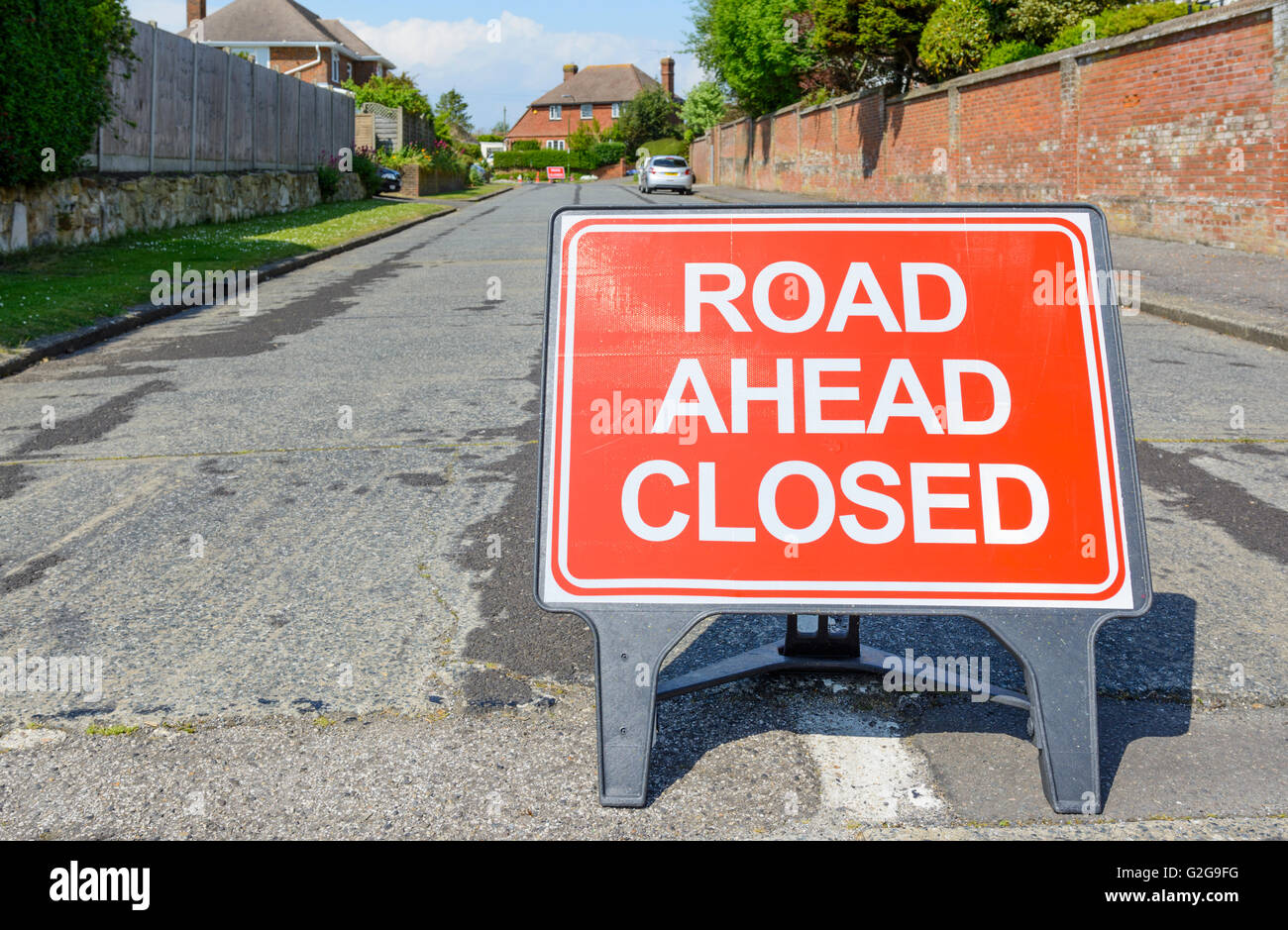 Road ahead closed sign on a road in the UK. - Stock Image