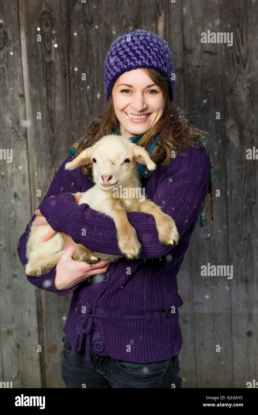 49c2ea20e Woman holding a lamb in her arms Stock Photo  104851360 - Alamy