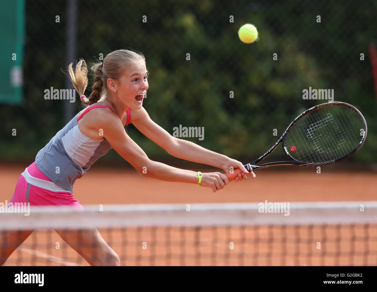Girl, 11, playing tennis, hitting a backhand volley, Munich, Upper Bavaria, Bavaria, Germany - Stock Image