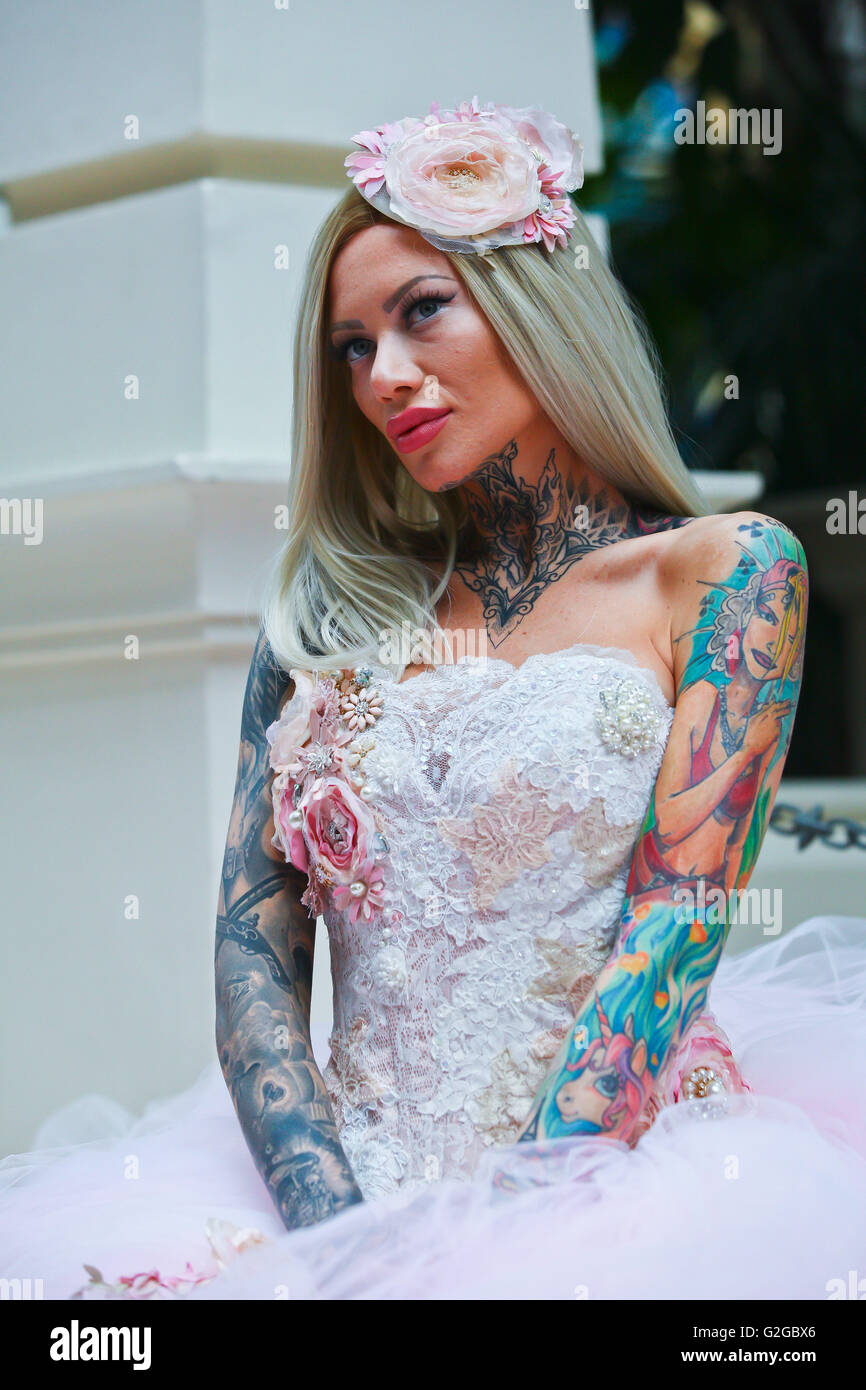 becky holt showcasing tattoos and wedding dress by philippa lusty at