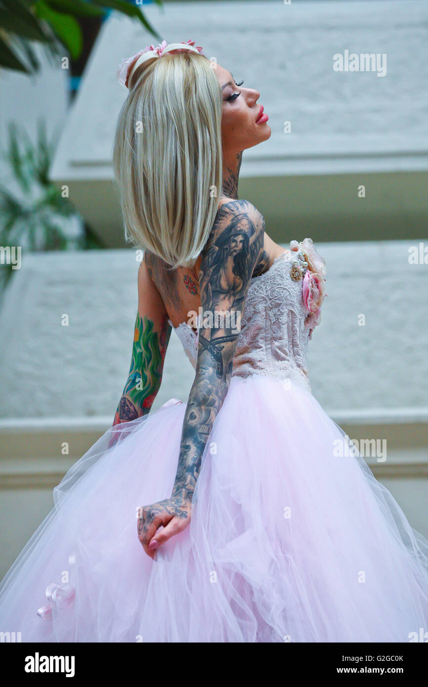 Becky Holt showcasing tattoos and wedding dress by Philippa Lusty at ...