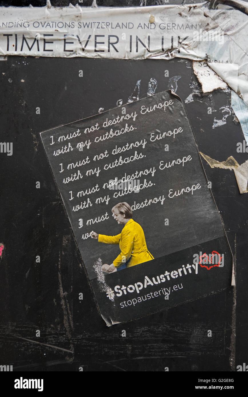 Anti-austerity sticker featuring Angela Merkel on a litter bin in Edinburgh. - Stock Image