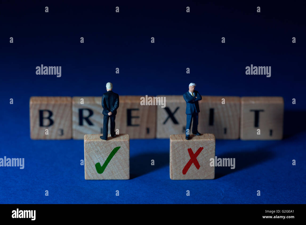 Brexit spelled out with undecided businessman - Stock Image