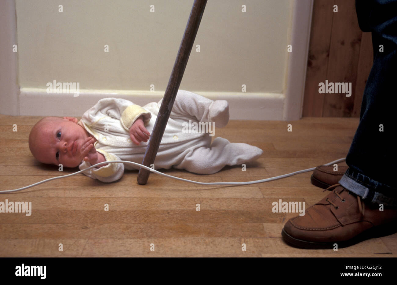 first aid for baby following electric shock - Stock Image