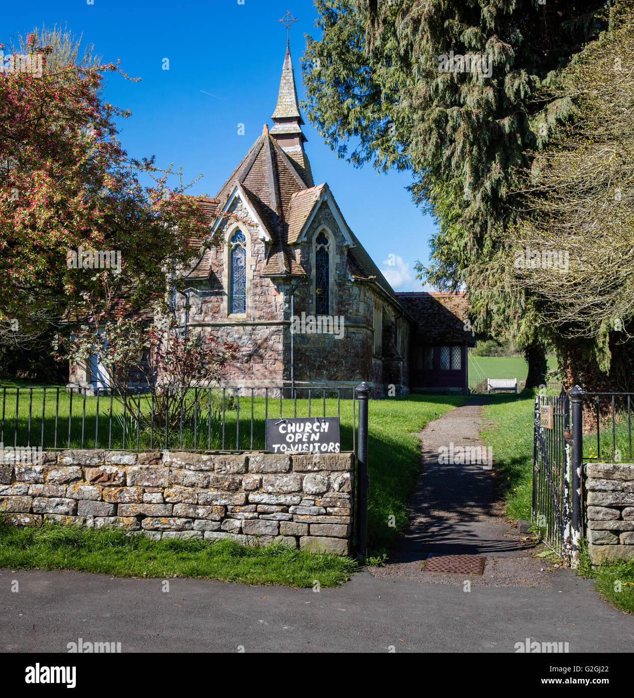 Village church with small spire in the village of Purton on the banks of the estuarine River Severn in Gloucestershire - Stock Image