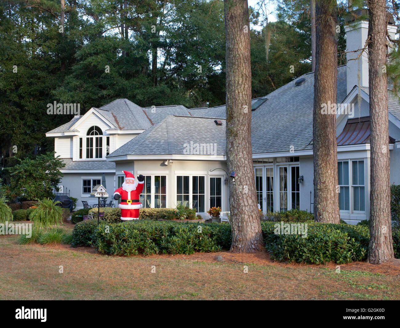 Suburban home with inflatable Santa Claus in South Carolina suburban retirement community - Stock Image