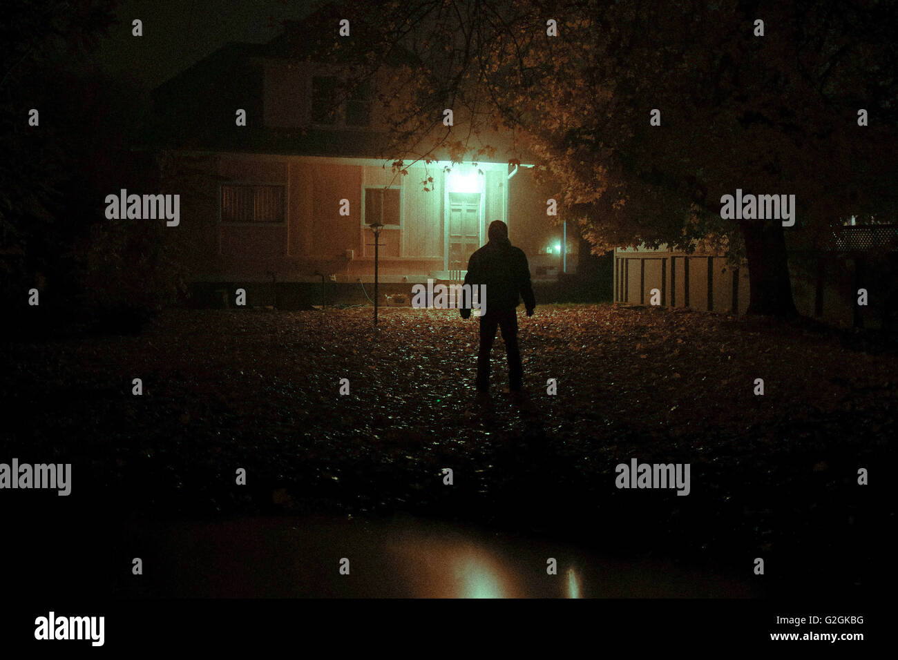 Mysterious Man Looking At House From Backyard At Night Stock Photo Alamy