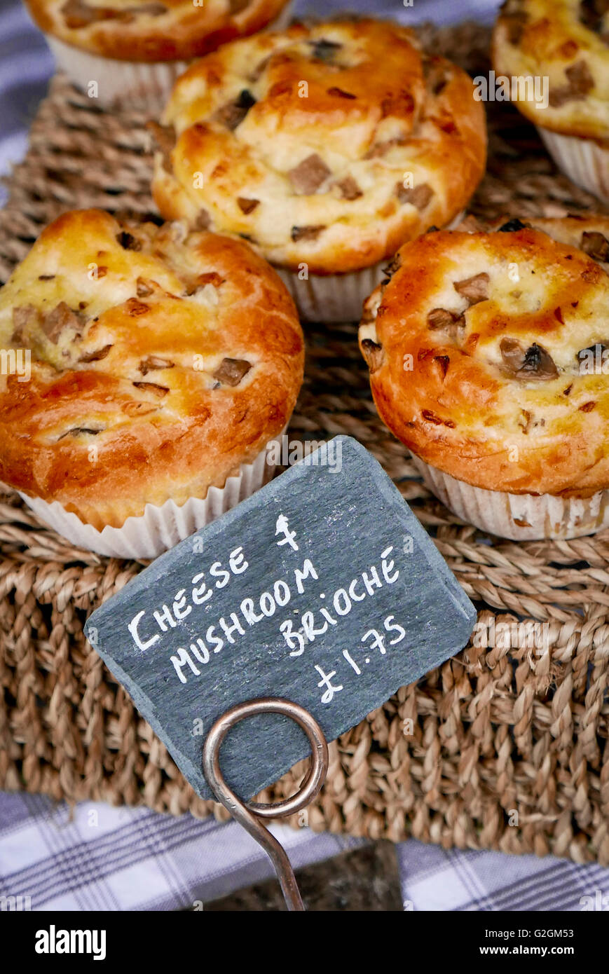 Cheese and mushroom brioche on a stall at Wanstead monthly Farmers market, Wanstead, London E11 Stock Photo