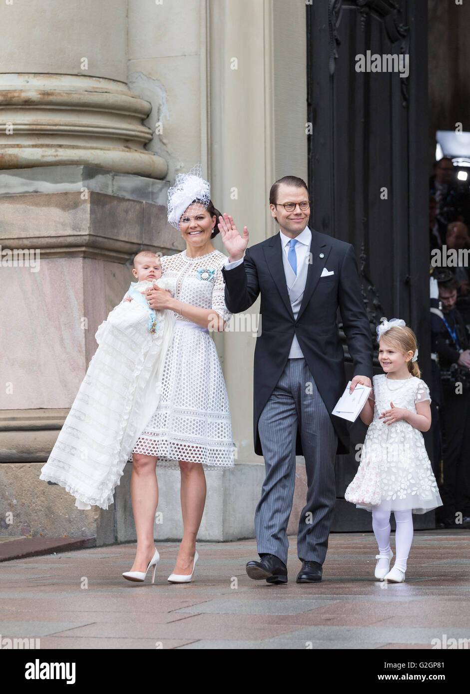 Baby Prince Oscar of Sweden's christening – family exits the Royal chapel. Prince Daniel waves - Stock Image