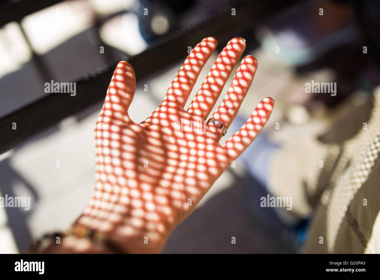 Shadow pattern on the hand - Stock Image