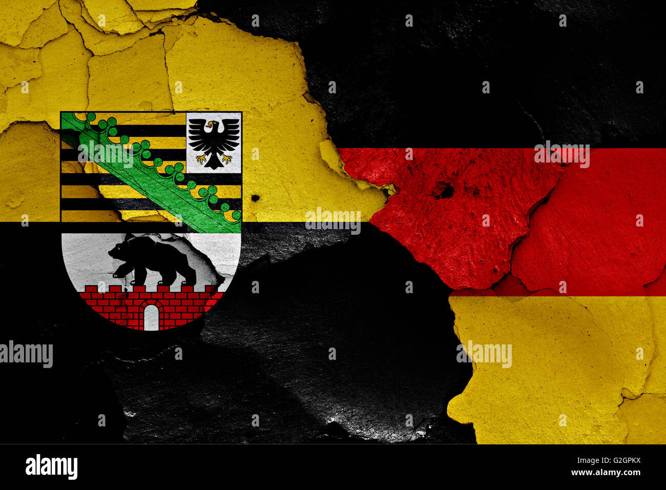 flags of Saxony Anhalt and Germany painted on cracked wall - Stock Image
