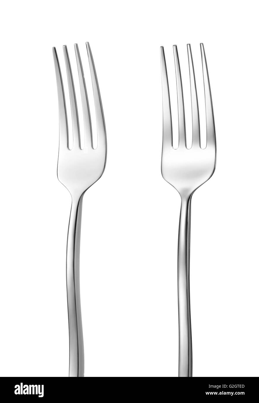 two steel forks isolated on white background - Stock Image