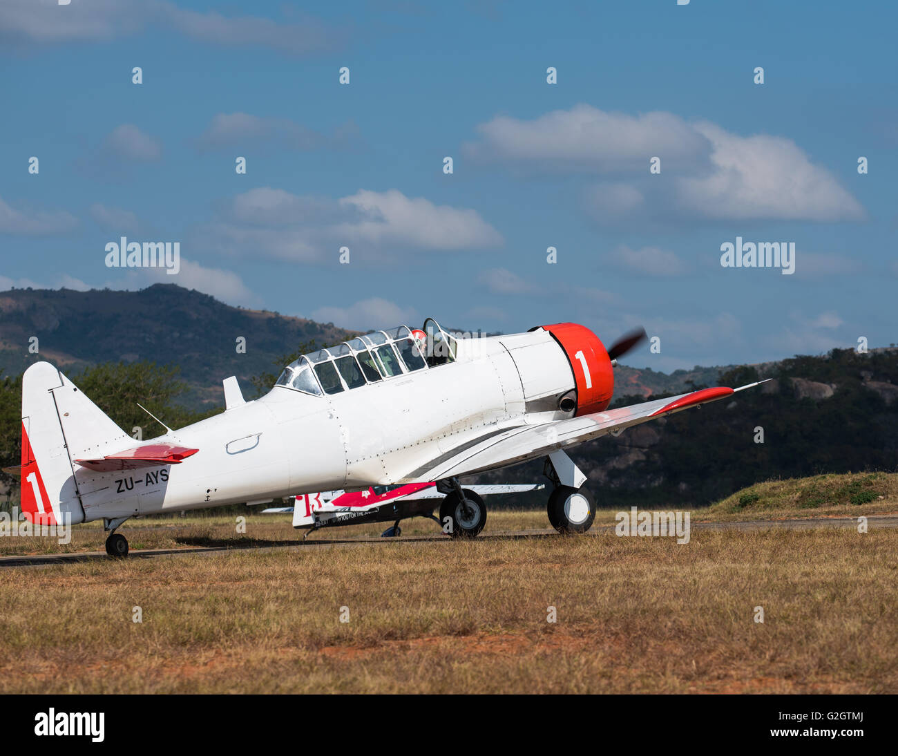 Harvard and pilot on the runway at the Lowveld Airshow - Stock Image