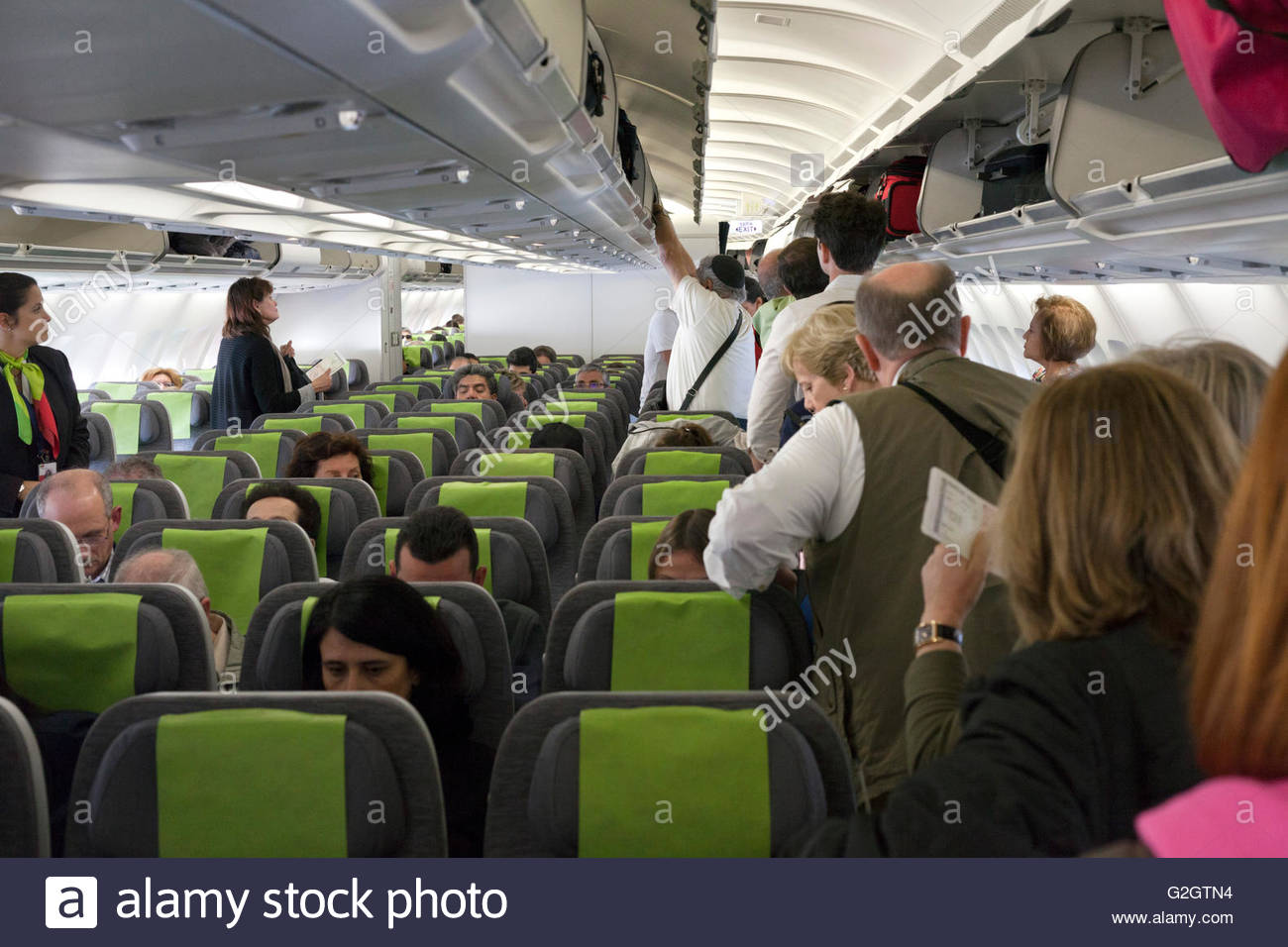 Passengers During Boarding Of The Airplane