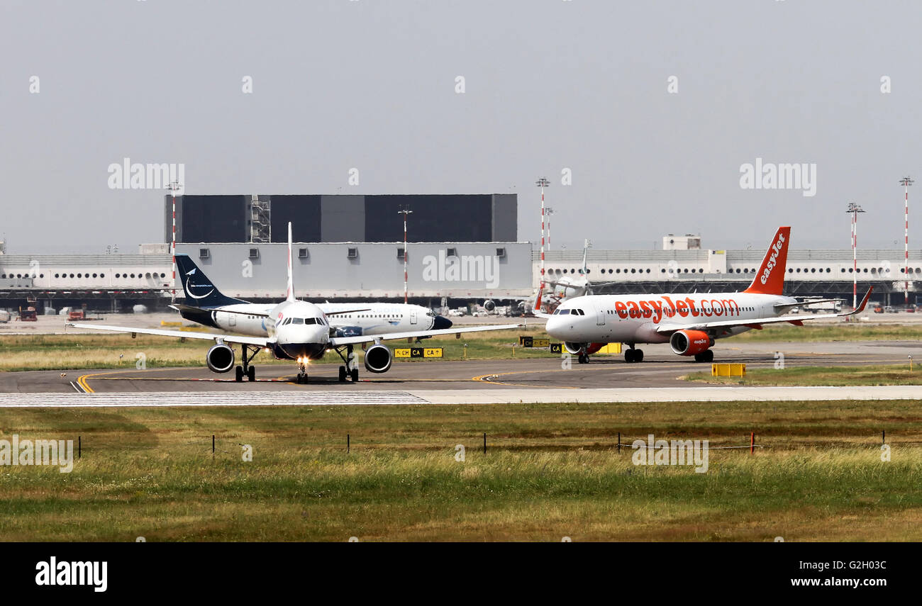Airplanes ready for takeoff at Malpensa airport, Milan, Italy - Stock Image