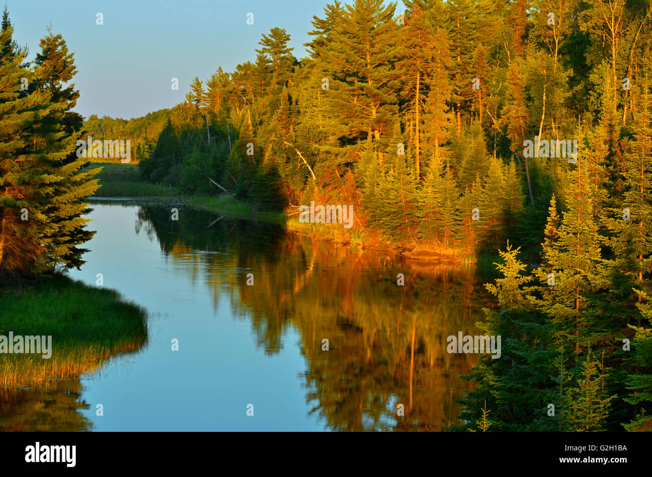 Sun setting on water at Reed Narrows, connected to Lake of the Woods, Reed Narrows, Ontario Canada - Stock Image