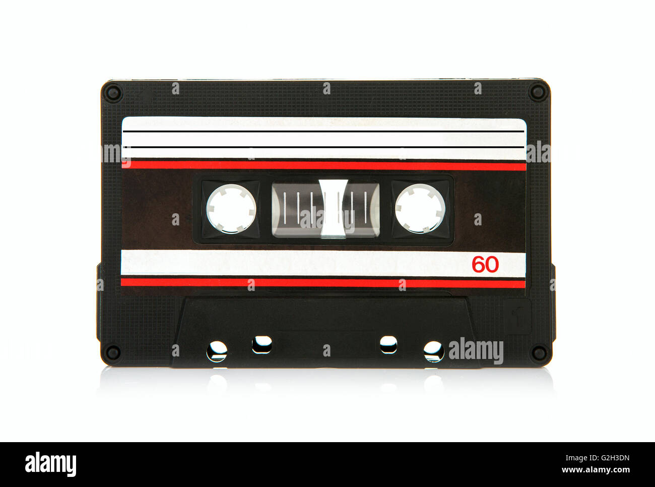 Vintage compact cassette audio tape on a white background - Stock Image