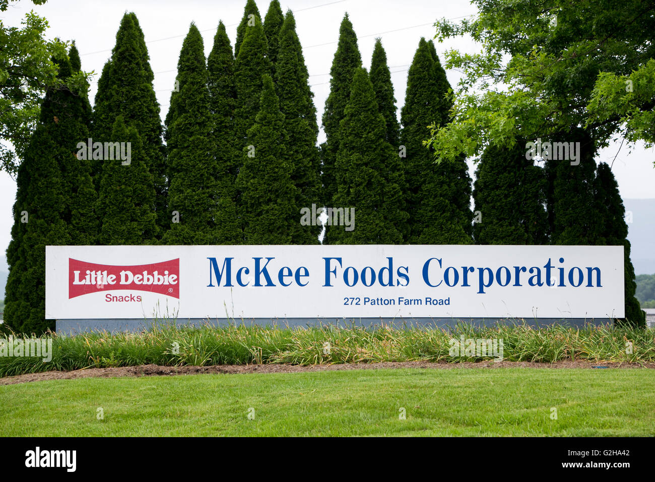 A logo sign outside of a facility occupied by the McKee Foods Corporation, parent company of Little Debbie snacks, - Stock Image