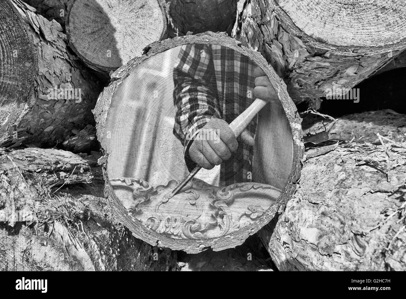 Part of woodpile and Woodworker at work painted on texture Stock Photo