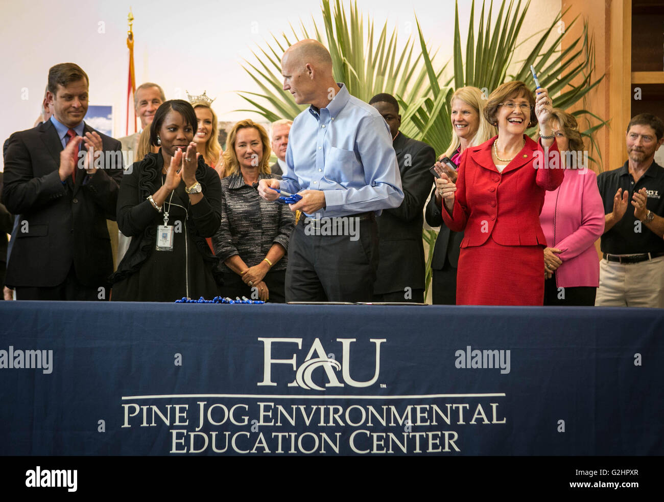 West Palm Beach, Florida, USA. 31st May, 2016. Rep. Gayle Harrell (right) celebrates after Gov. Rick Scott signs Stock Photo