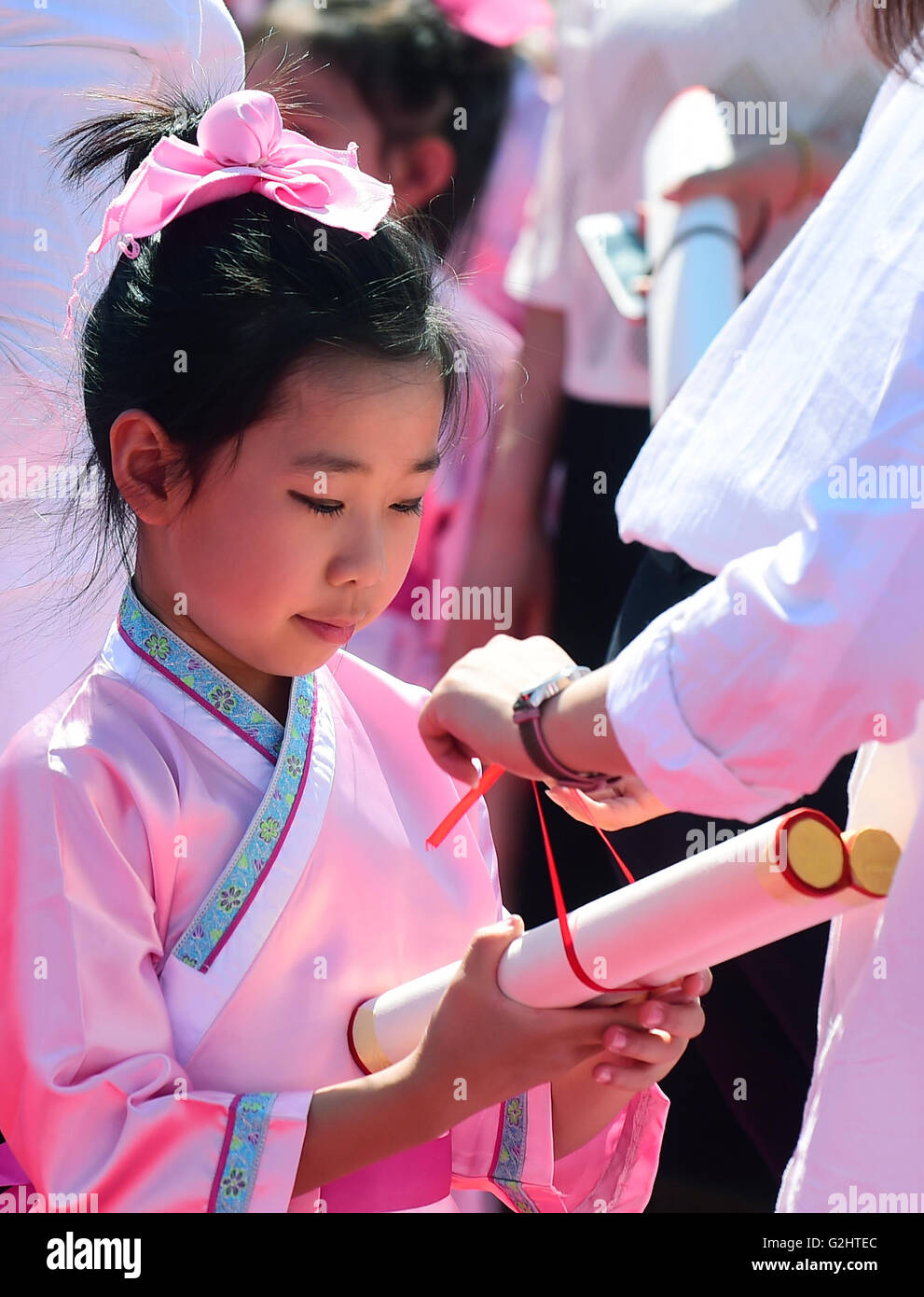 Changchun, China's Jilin Province. 1st June, 2016. A kid attends a first writing ceremony, also called Qi Meng - Stock Image