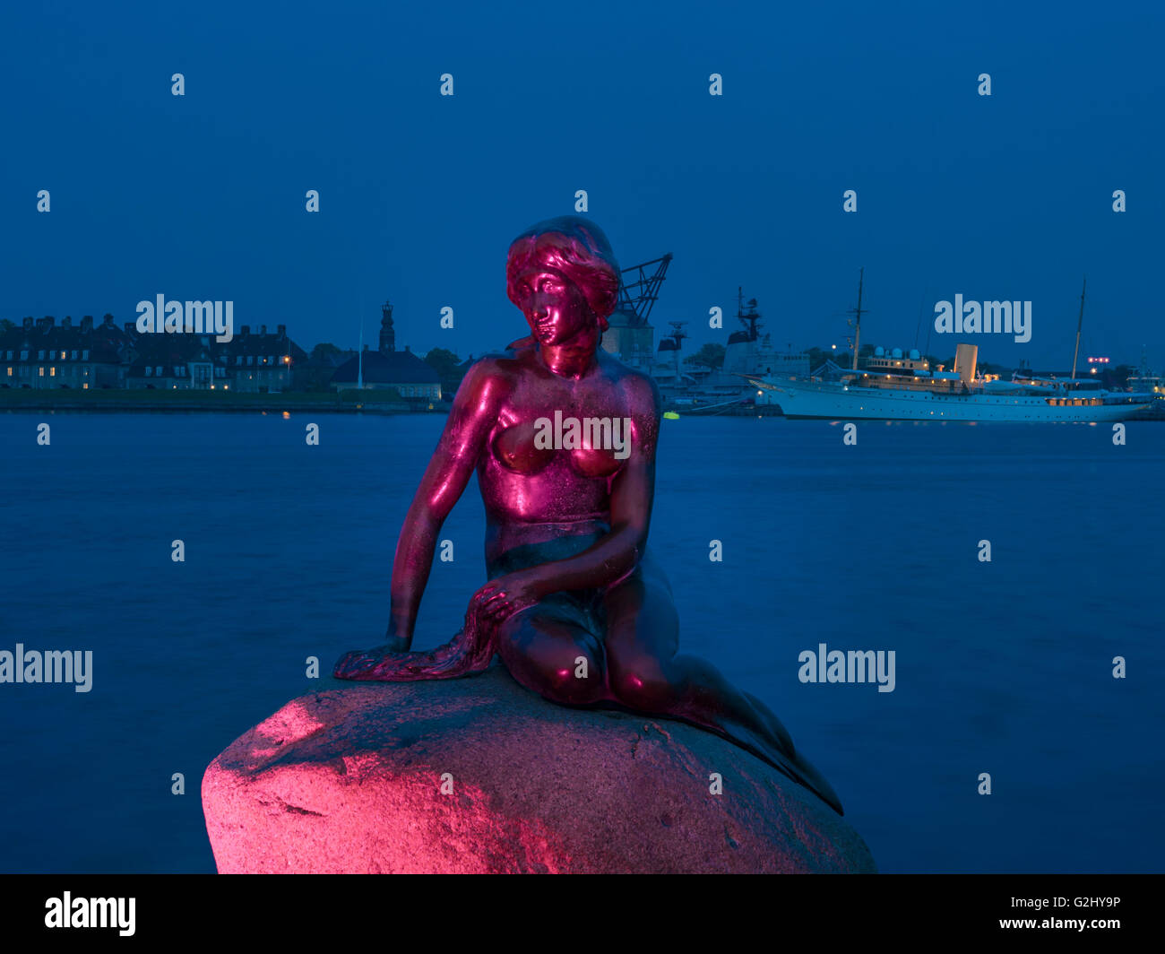 The Mermaid, sculpture, landmark of Copenhagen, in the background the Danish royal yacht Dannebrog, Copenhagen Harbour, - Stock Image
