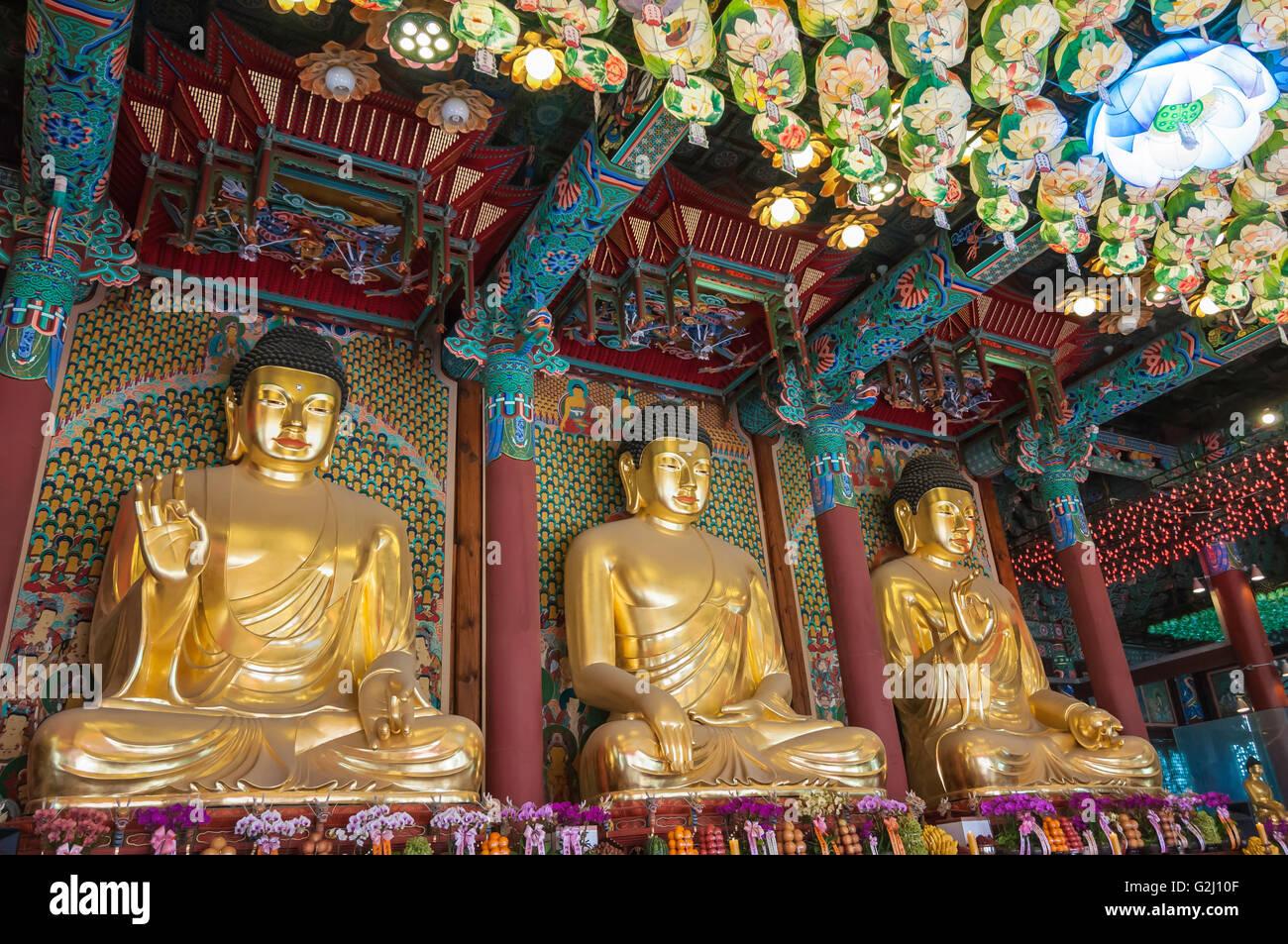 Golden Buddha statues inside the Daeungjeon, Main Dharma Hall, Jogyesa, Seoul, South Korea Stock Photo