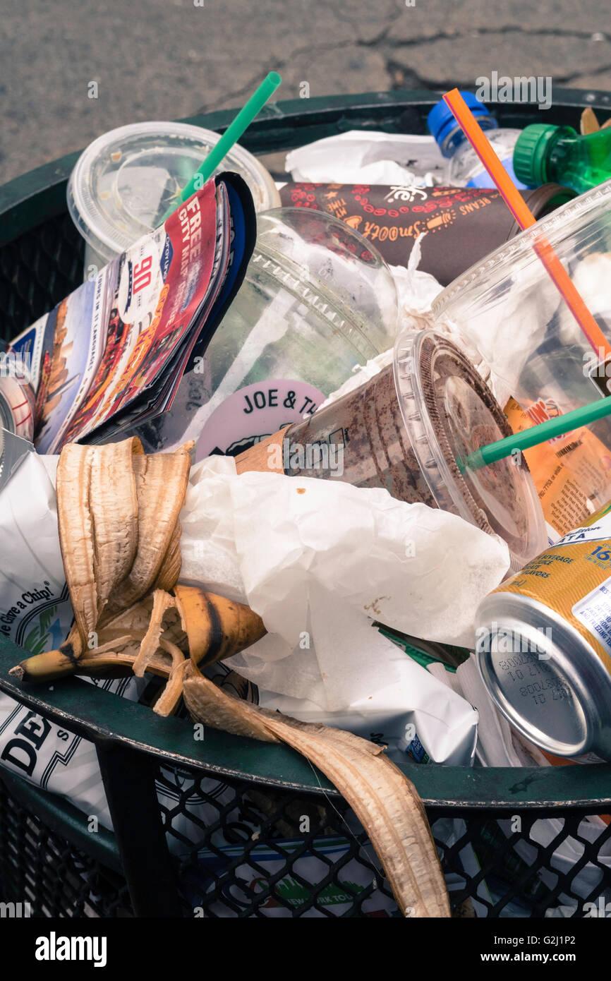 Trash can on an urban street, NYC - Stock Image