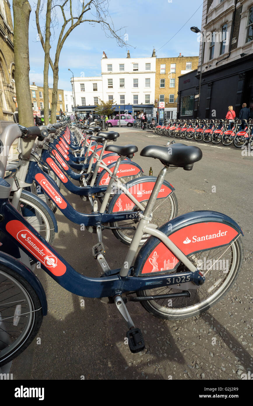 Rows of hire bikes for traveling around the city of London sponsored by Santander offering cheap environmentally - Stock Image