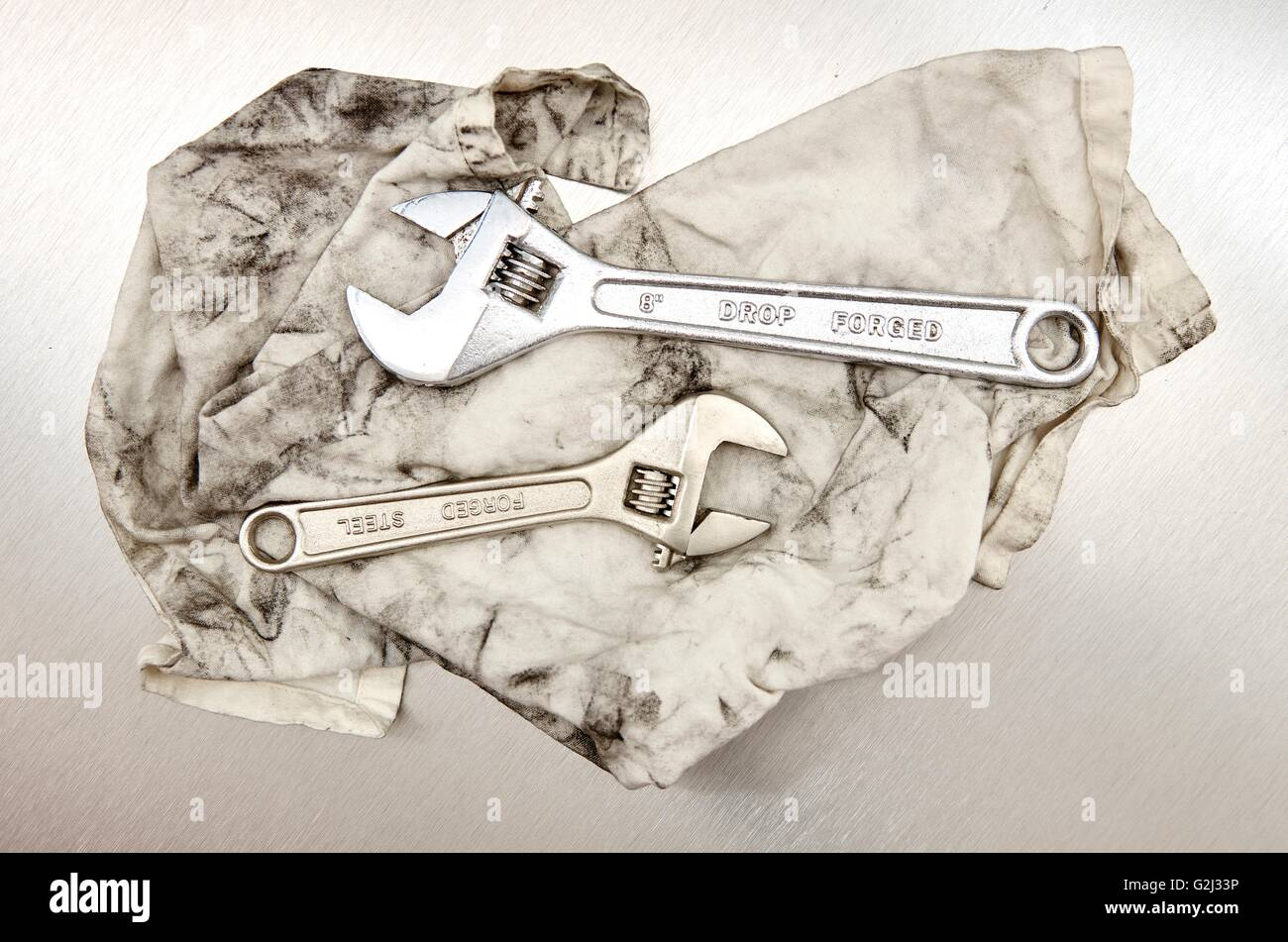 ebf64a4d35104a A studio photo of a wrench on an oily rag Stock Photo: 104889114 - Alamy