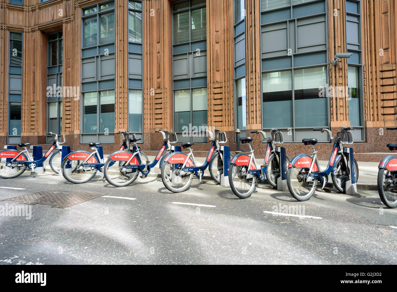 Hire bikes for traveling around the city of London sponsored by Santander offering cheap environmentally friendly - Stock Image