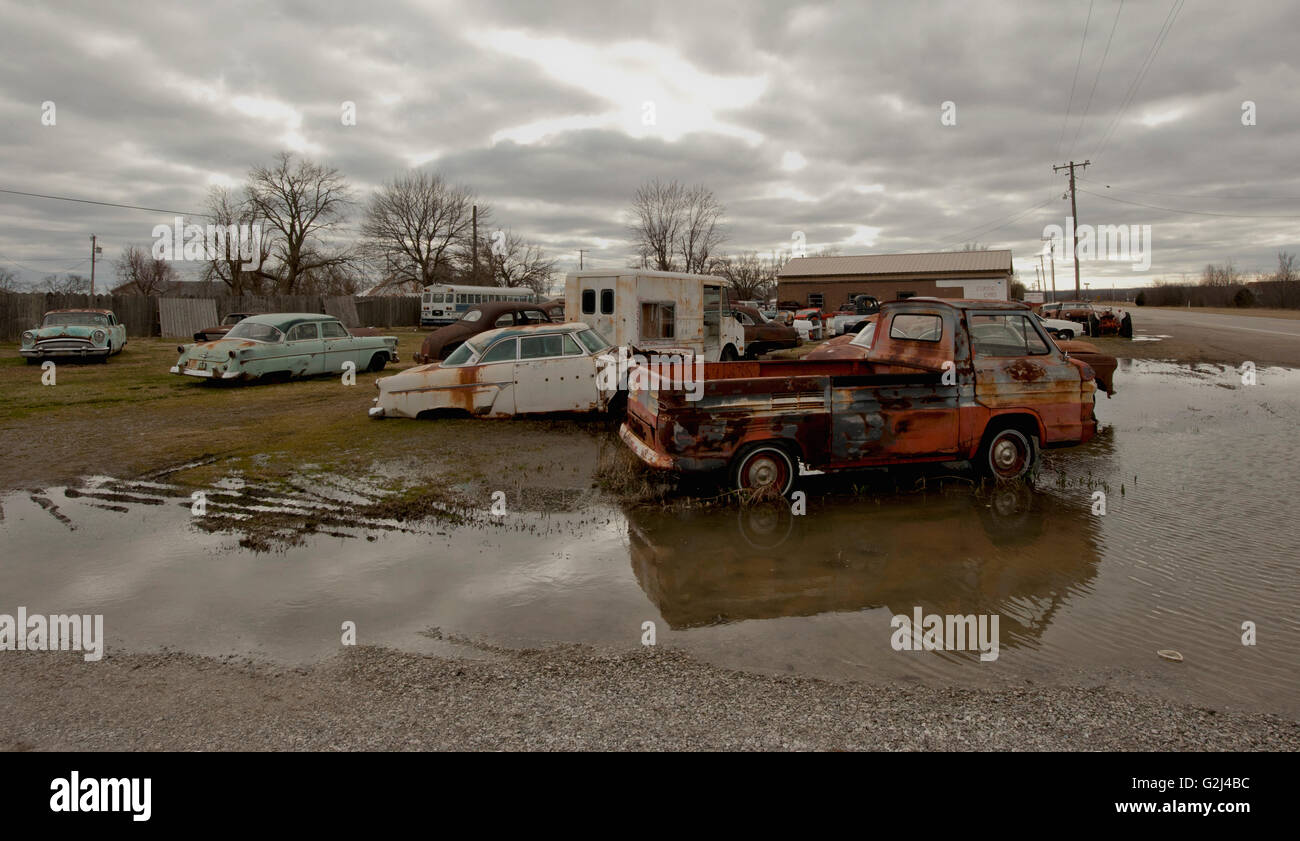 Junk Cars by Side of Road After Rain, Kansas, USA - Stock Image