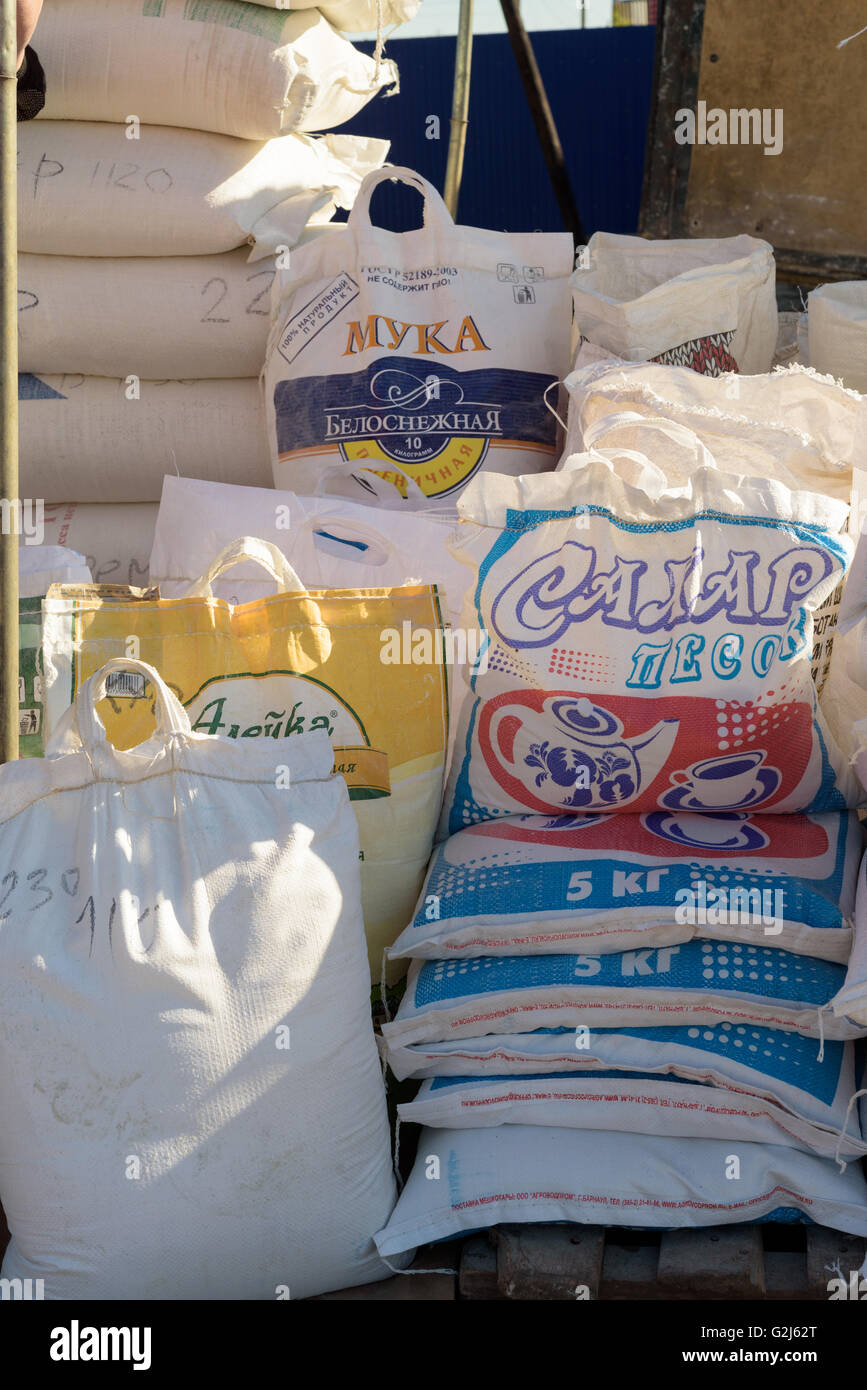 Large Bags Of Flour And Sugar For Sale At A Local Market Stall In