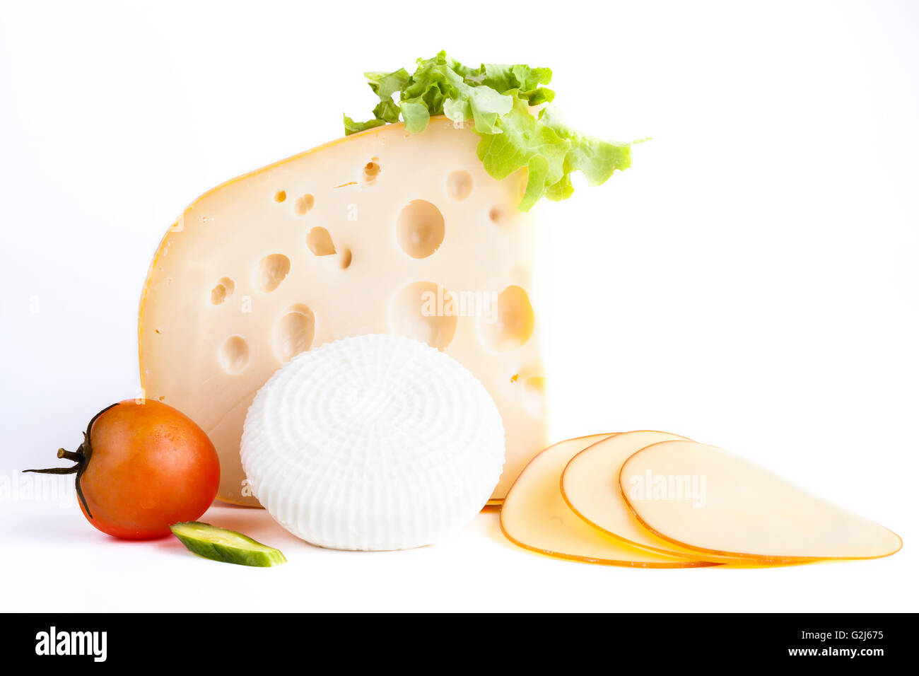 Yellow and white chese with tomato and cheese slices isolajted on white background - Stock Image