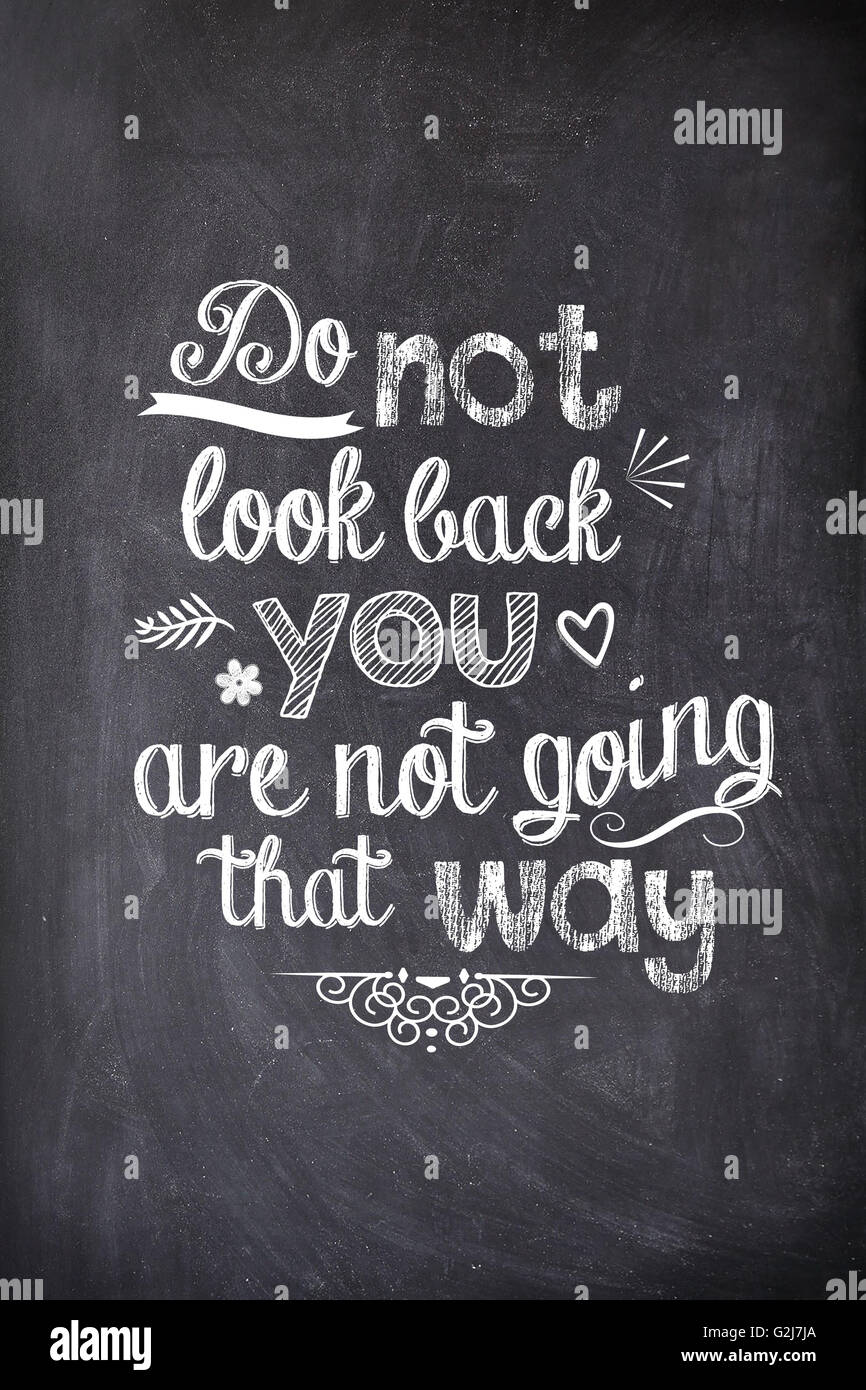 Motivational quote written with chalk on a blackboard - Stock Image
