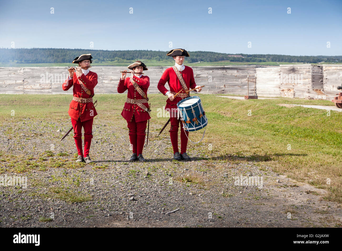 Soldiers playing instruments before cannon fired Fortress Louisbourg National Historic Site Canada in Louisbourg - Stock Image