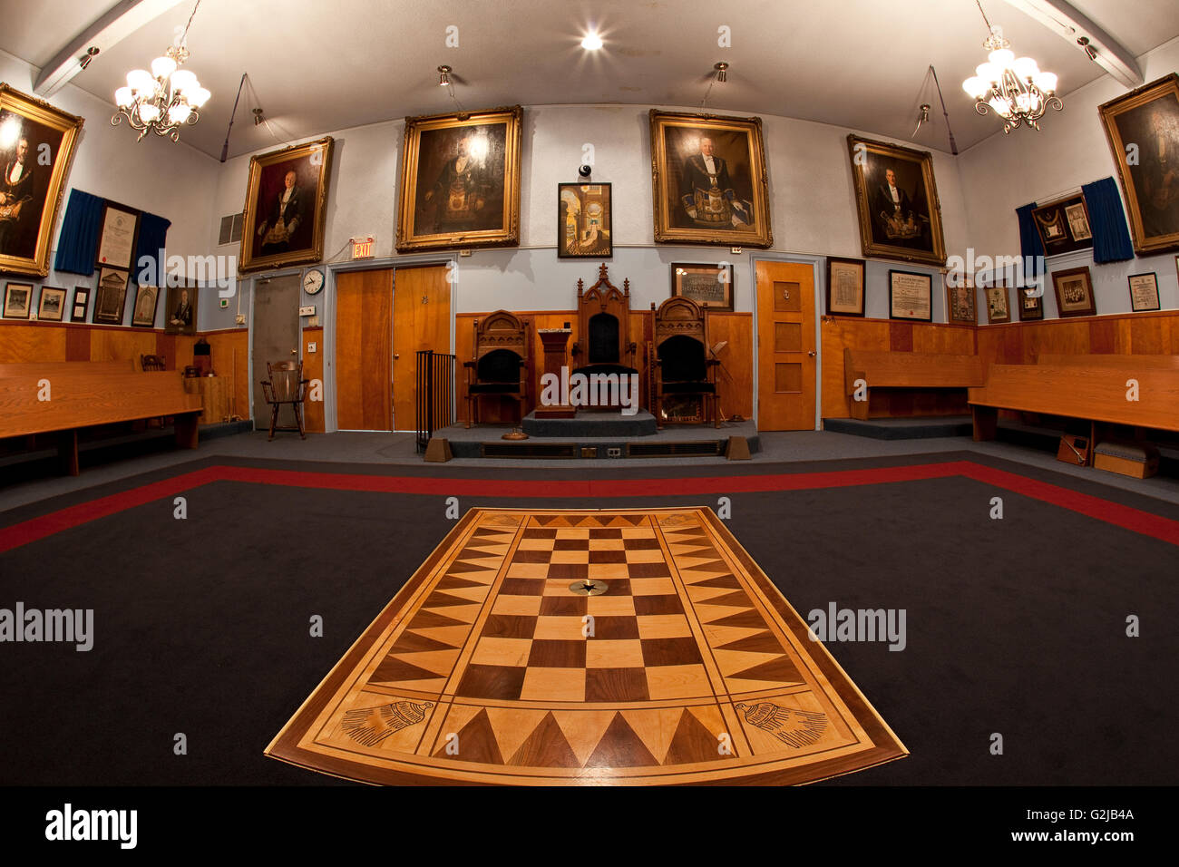 Inside Masonic Hall looking toward Senior Warden's Chair flanked Junior Deacon's Chair on left Junior Warden's - Stock Image