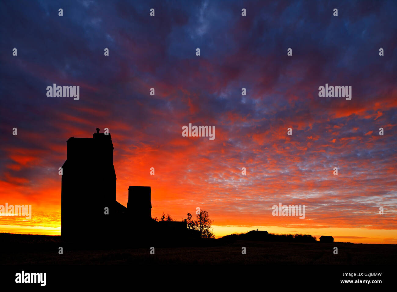 Grain elevators at sunrise in ghost town, Lepine, Saskatchewan, Canada - Stock Image
