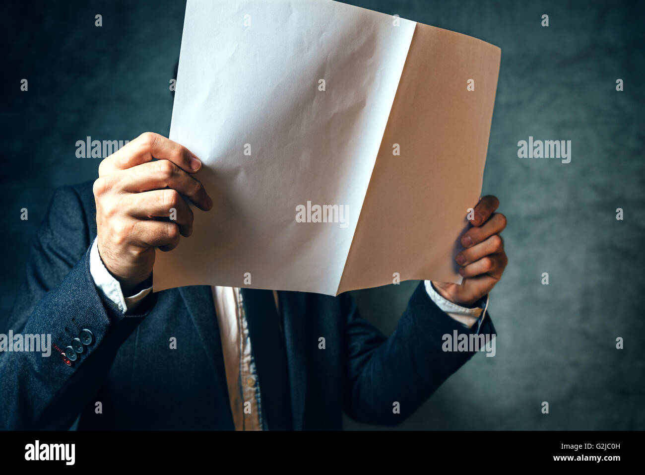 Businessman reading project documentation, well dressed business office manager analyzing document. - Stock Image
