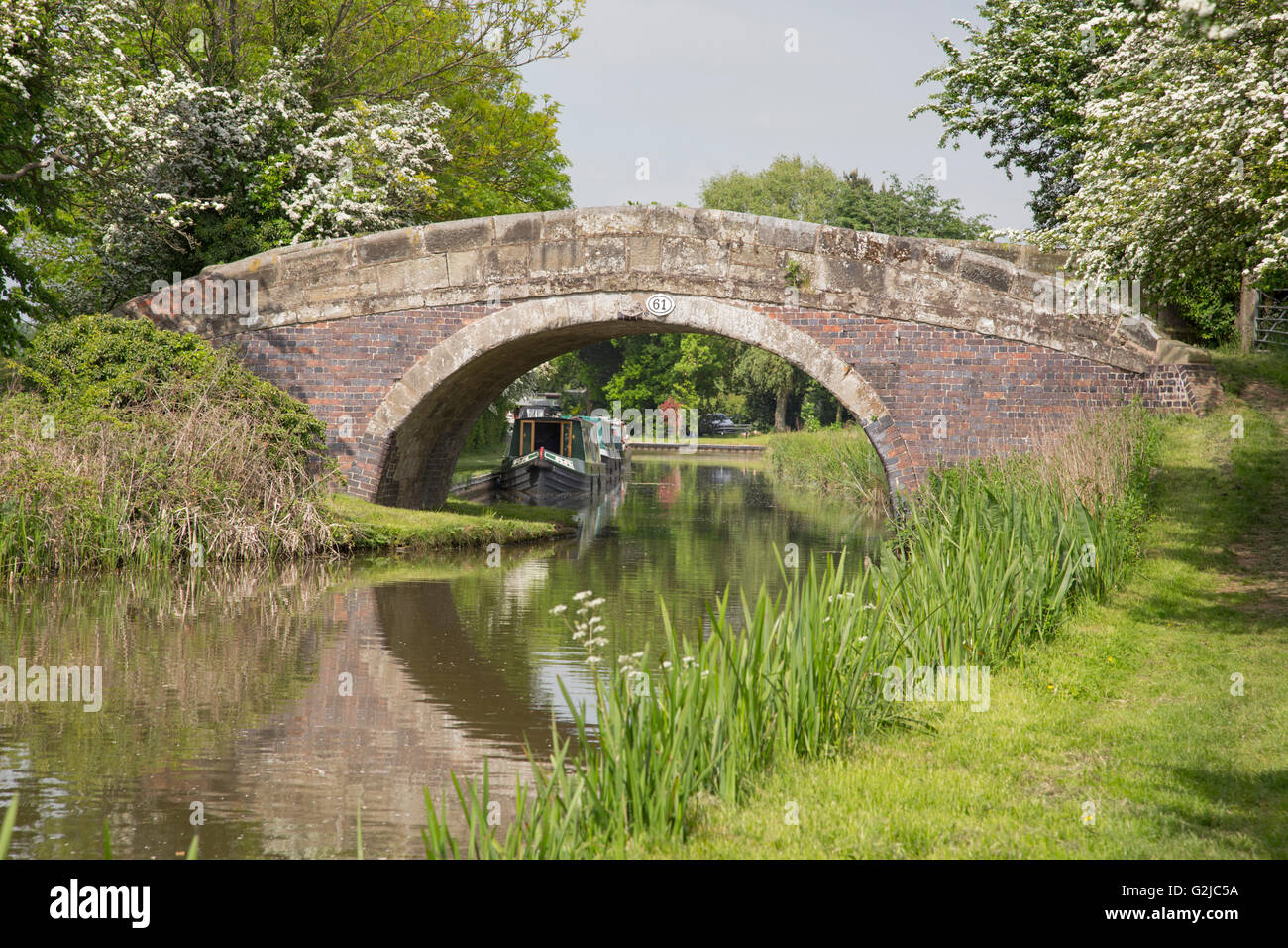 Picturesque canal bridge on the Ashby canal, Leicestershire, England, UK - Stock Image