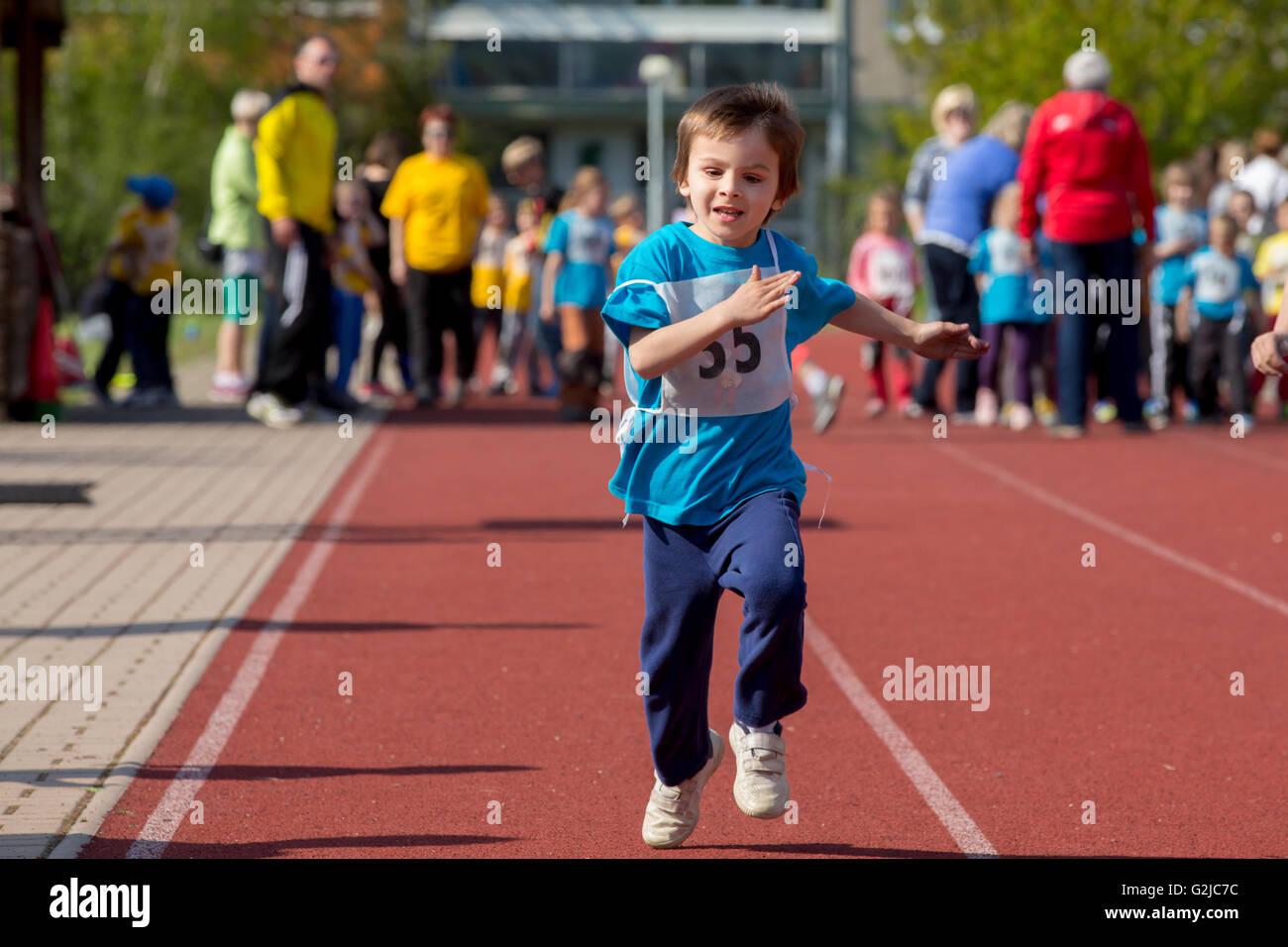 Young preschool children, running on