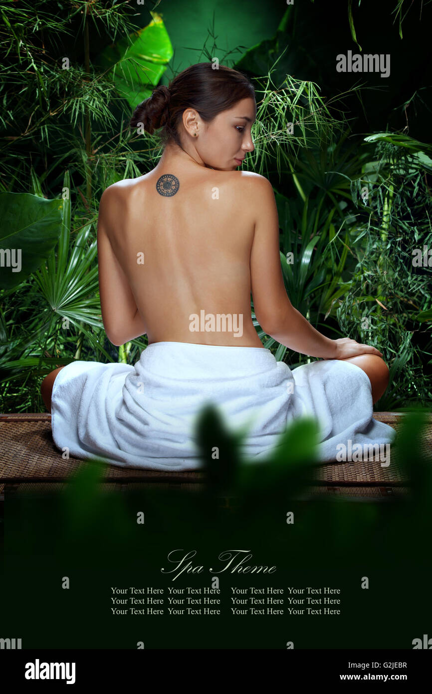 portrait of young beautiful woman  in spa environment - Stock Image