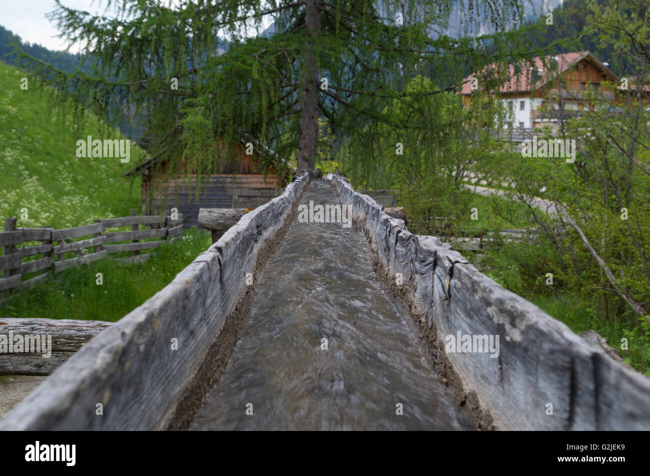 Original wooden irrigation water channel of a mill in italy - Stock Image