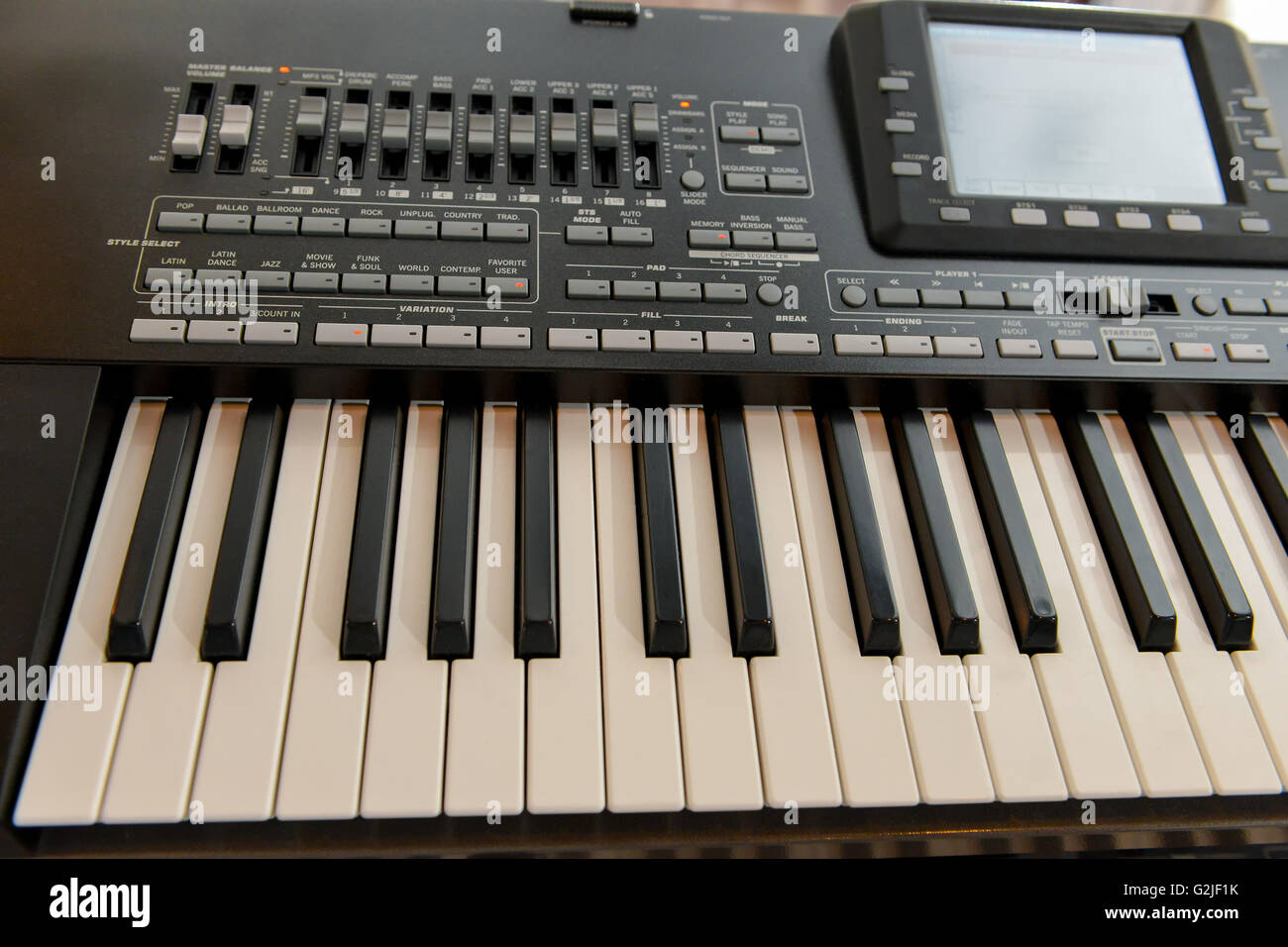Music workstation synthesizer with digital display and side light - Stock Image