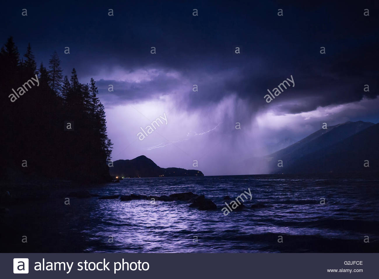 Lightning and a passing rainstorm over Kootenay Lake, Ainsworth Hot Springs, British Columbia, Canada - Stock Image