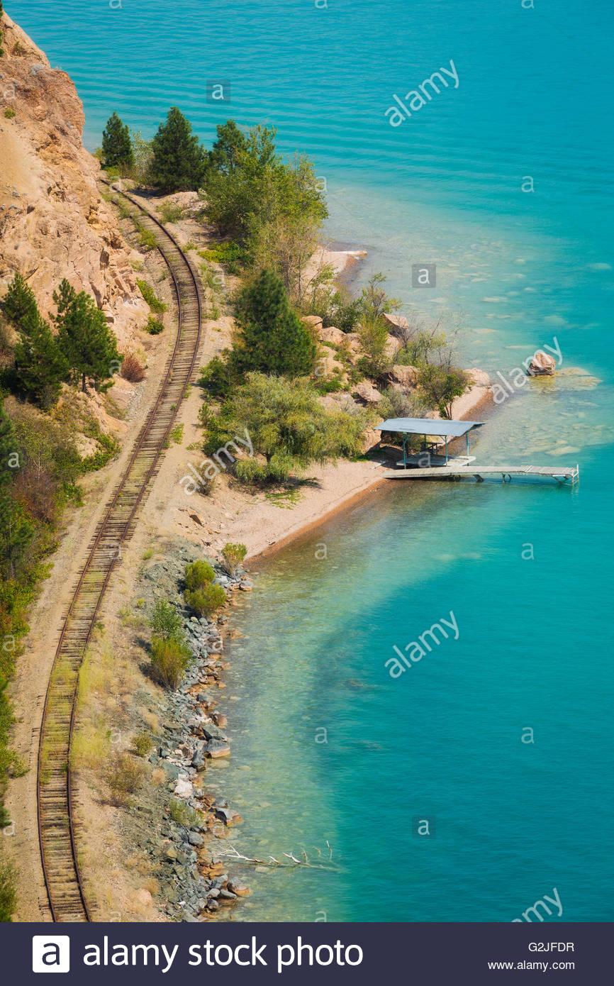 Railway track skirts the edge of Kalamalka Lake, British Columbia, Canada Stock Photo
