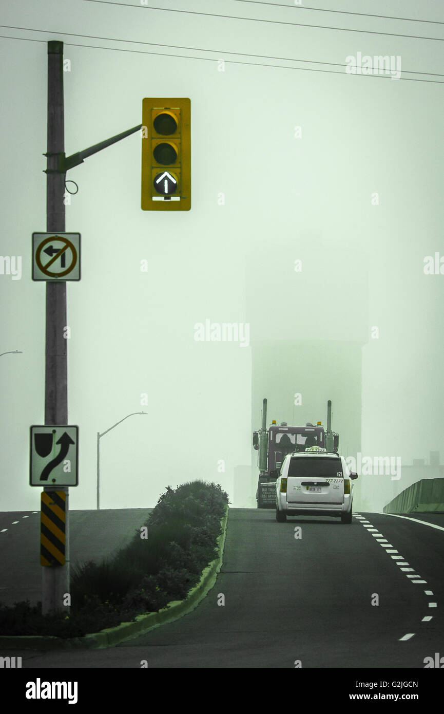 traffic lights and road signs - Stock Image