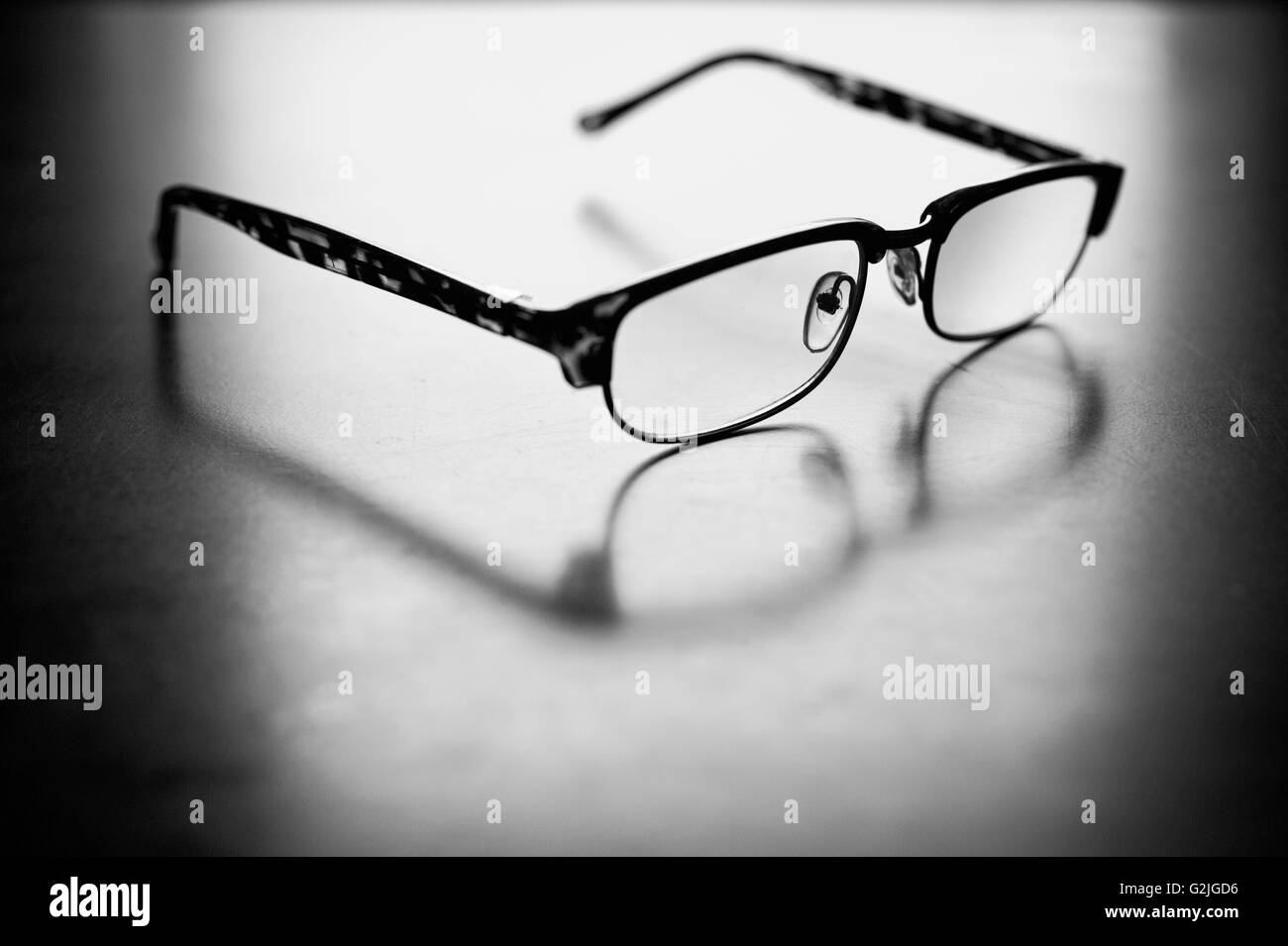 Eyeglasses on a white sheet of paper - Stock Image